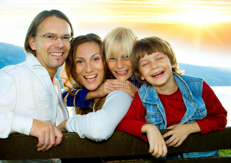 Family time 6. Happy family in the sunset royalty free stock photos