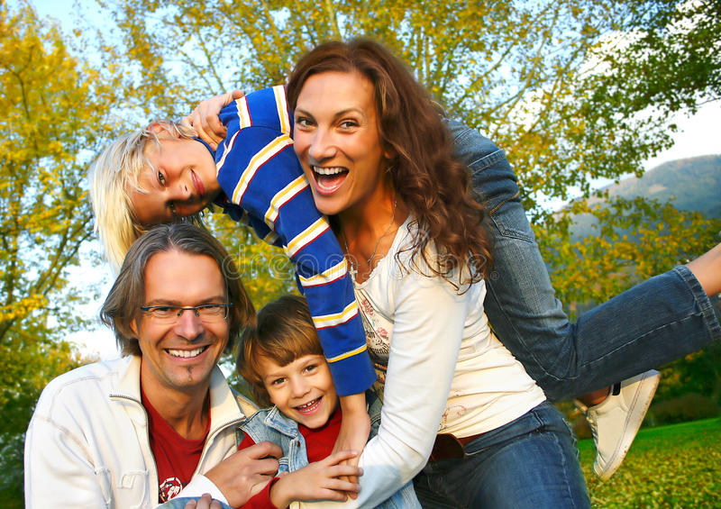Family time 7. Happy family in a park royalty free stock image