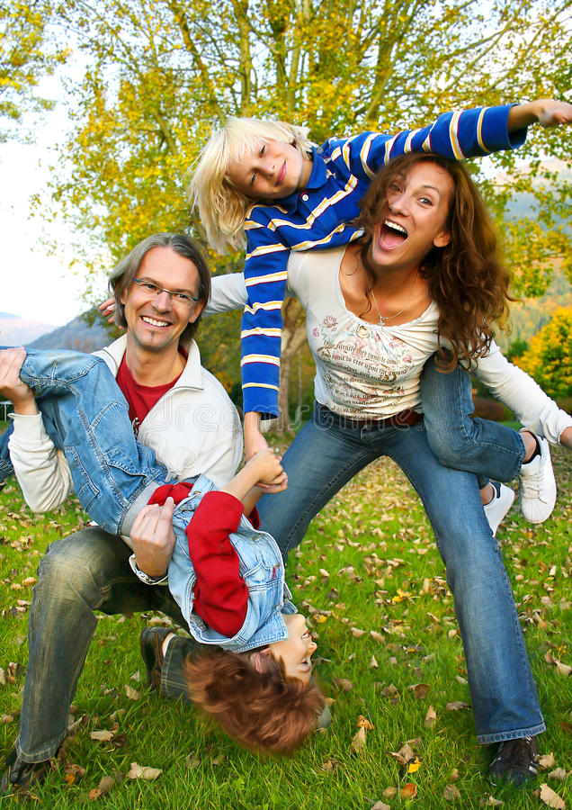 Family time 8. Happy family in a park stock photos
