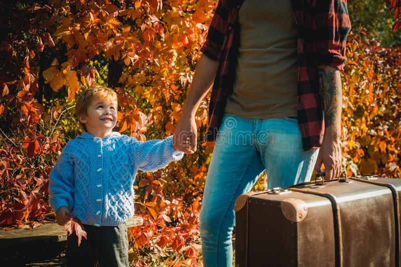 Family time. Adventure with son. Telling stories about past times. Father with suitcase and his son. Bearded dad telling stock image