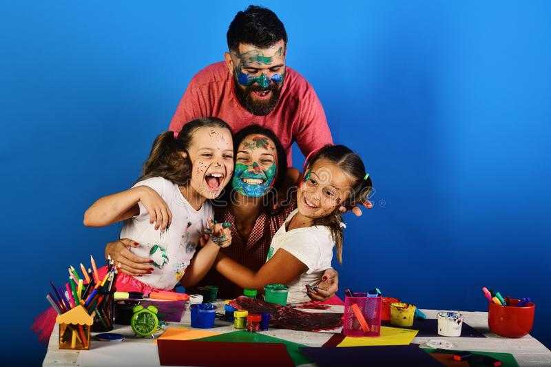 Family time and art concept. Artists create artwork and hug stock image