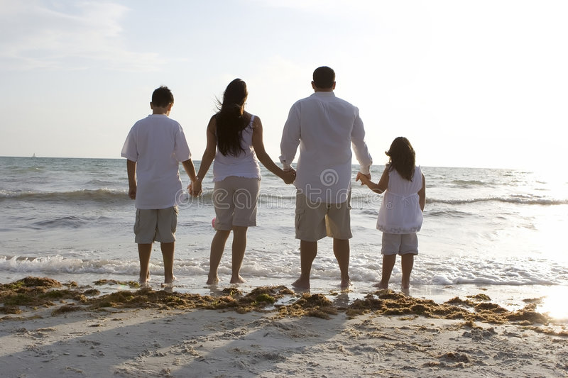 Family time on a beach stock photo