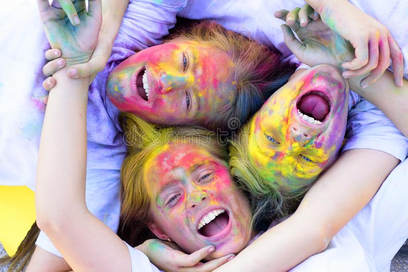 Family time. children with creative body art. Crazy hipster girls. Summer weather. colorful neon paint makeup. positive stock photo