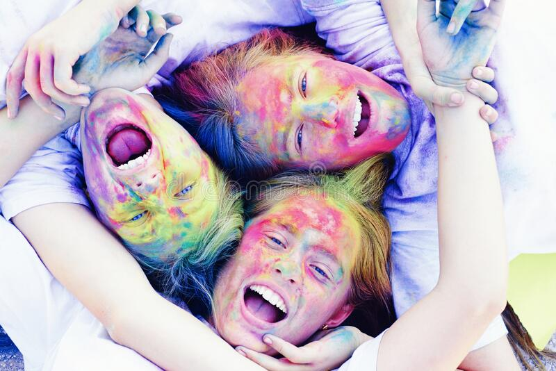 Family time. children with creative body art. Crazy hipster girls. Summer weather. colorful neon paint makeup. positive. And cheerful. Happy youth party royalty free stock image