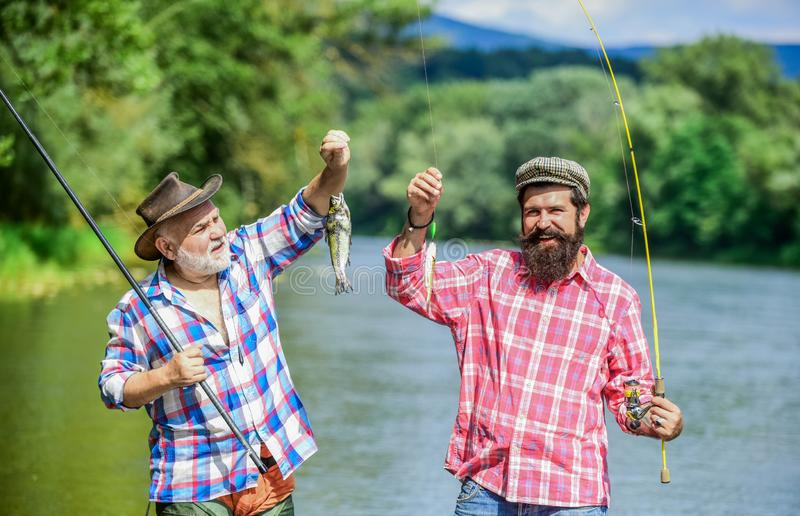 Family time. Fisherman with fishing rod. Activity and hobby. Fishing freshwater lake pond river. Bearded men catching stock photos