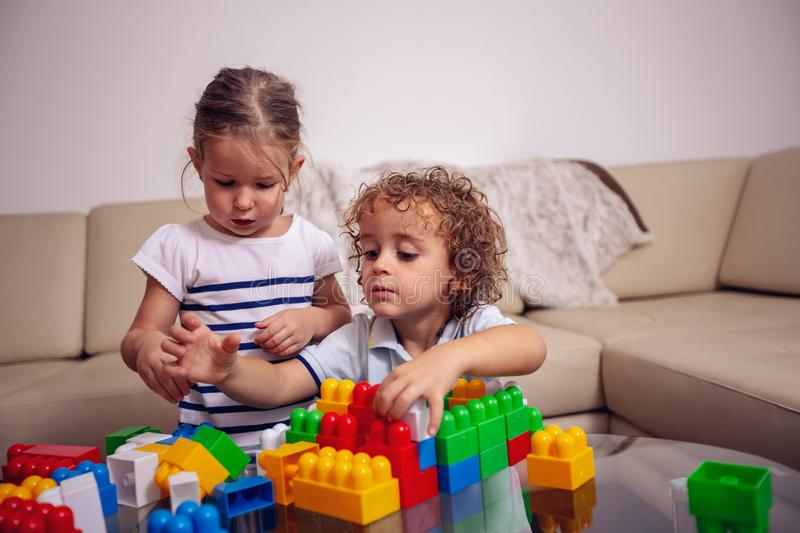family time - girl and boy playing with toys and having fun together. royalty free stock photos