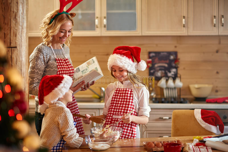 Family time- making Christmas cookies stock photos