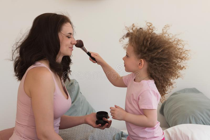 Family time. Mother and daughter. Cosmetics. royalty free stock photography