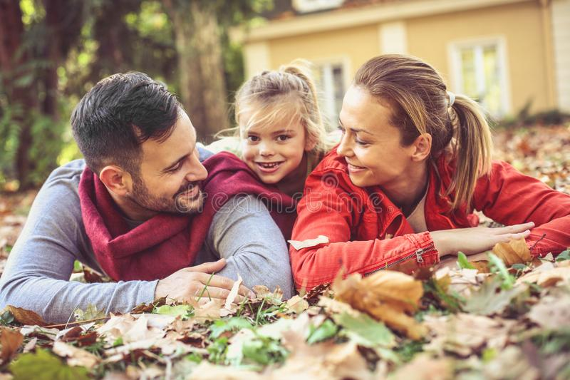 Family time . Parents poses with daughter. royalty free stock photography