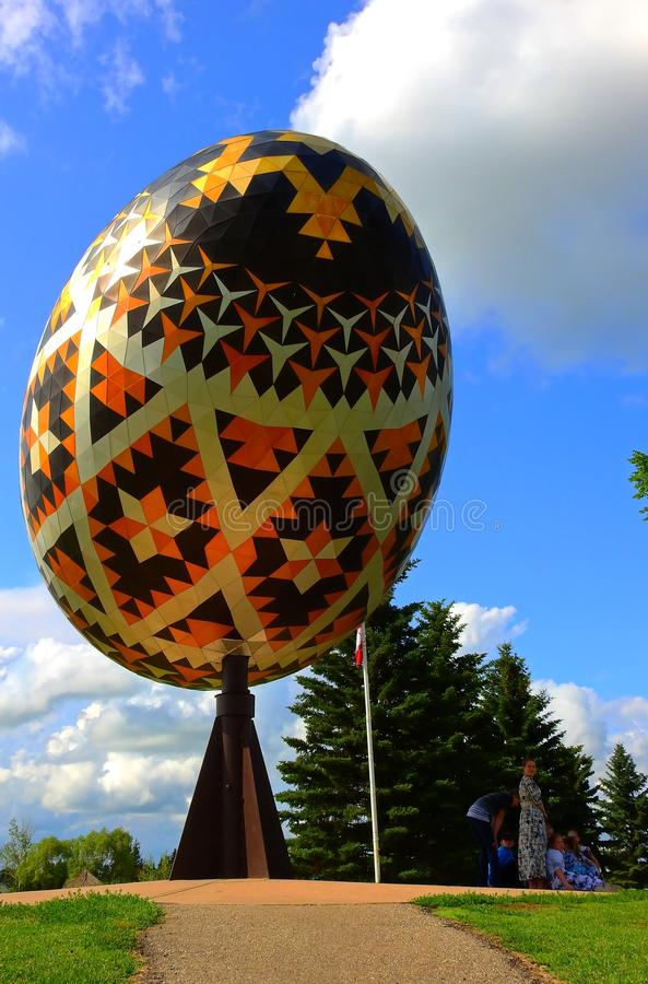 Family time in a park with a giant sculpture of a pysanka royalty free stock photos