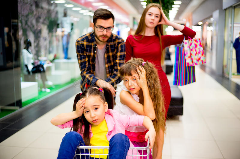 Family tired with shopping. A family of four is tired after shopping royalty free stock photography