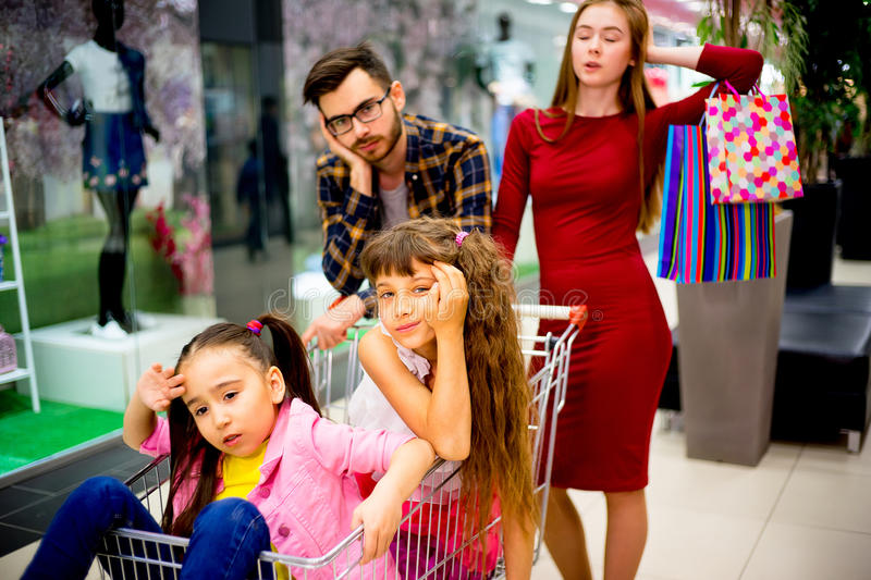 Family tired with shopping. A family of four is tired after shopping royalty free stock photos