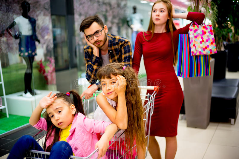 Family tired with shopping. A family of four is tired after shopping royalty free stock image