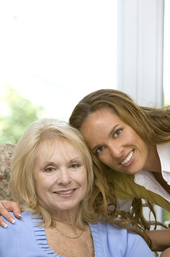 Family together. Mother and daughter enjoying time together in the house stock photo
