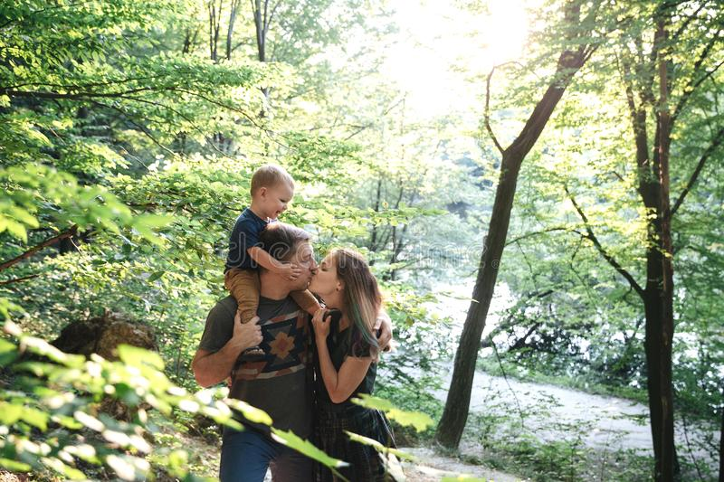 Family together on the bank of the river stock photography