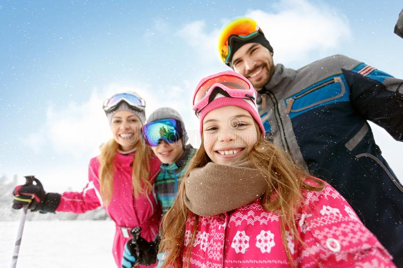 Family together on skiing stock photo