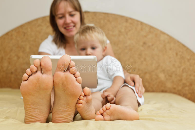 Family with touch pad at home royalty free stock photography