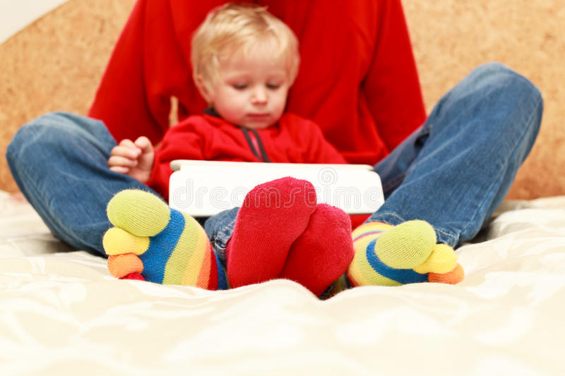 Download Family With Touch Pad At Home Stock Photo - Image: 27109928