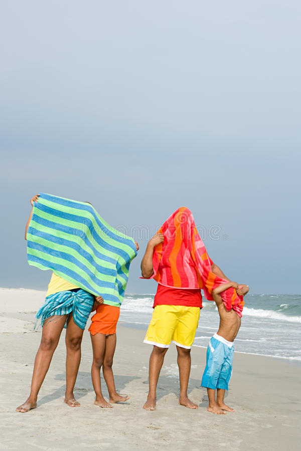 Family with towels over them stock photography