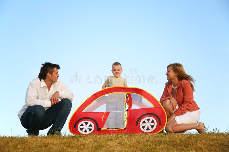 Family and the toy tent royalty free stock photos