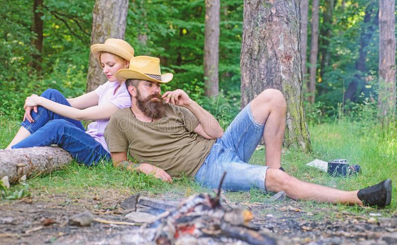 Family traditions. Family activity for summer vacation in forest and nature. Couple relaxing after gathering mushrooms royalty free stock images