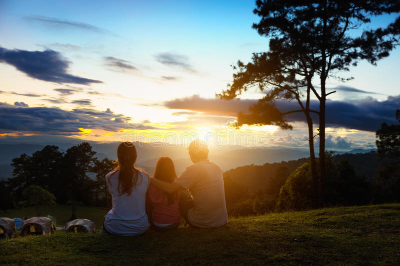 Family travel concept. Asian family seat on the top of mountain and look at sunset, Family travel concept stock photos
