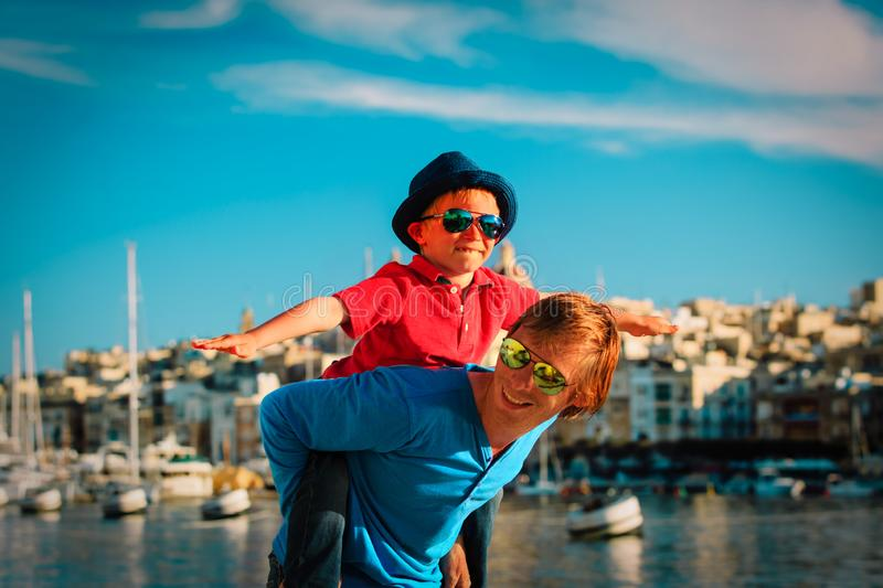 Family travel - father and son playing on the quay of Malta stock image