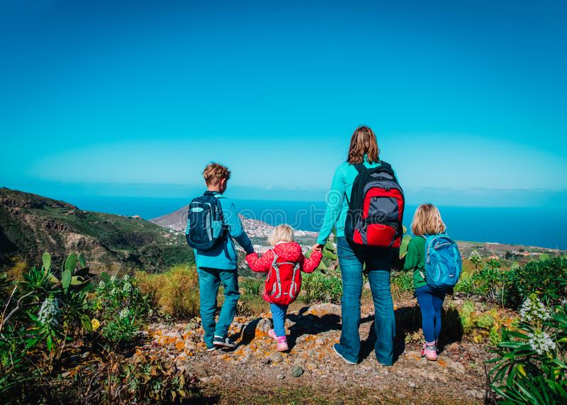 Family travel in nature, mother and kids enjoy hiking royalty free stock image