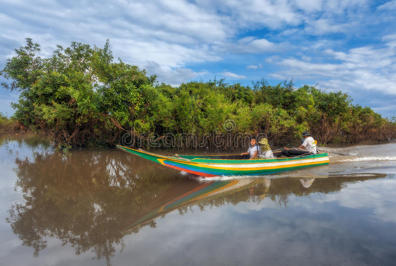 Family traveling by boat along the river Siem Reap. SIEM REAP, CAMBODIA DEC. 16: Cambodian people live on Tonle Sap Lake in Siem Reap, Cambodia on December 16 stock photos