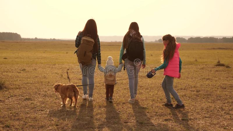 Family travels with the dog across the plains and mountains. mother, daughters and home pets tourists. teamwork of a. Family travels with the dog across the royalty free stock image