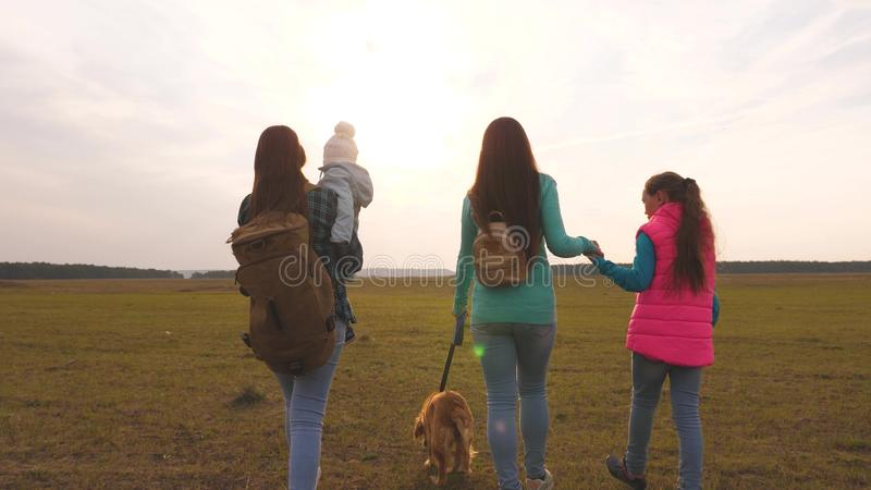 Family travels with the dog on the plain. teamwork of a close-knit family. mother, little child and daughters and pets. Family travels with the dog on plain royalty free stock photo