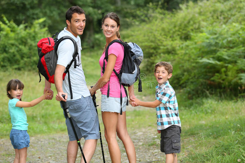 Family on a trekking day. In countryside royalty free stock photography