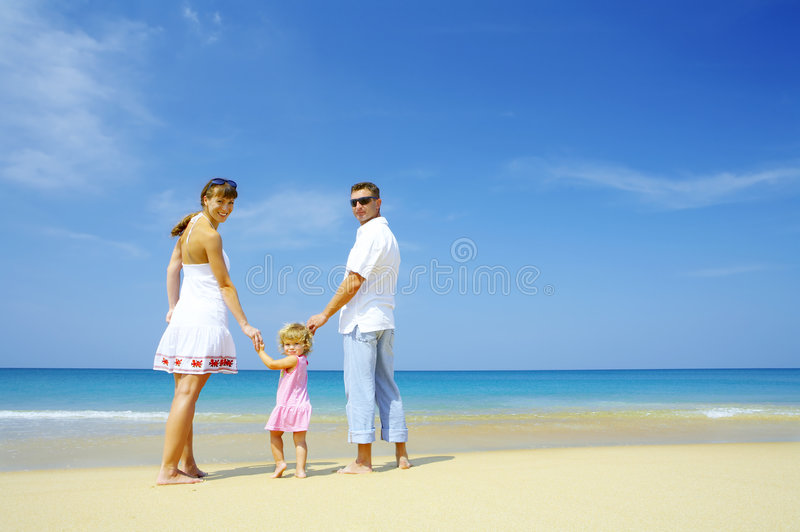 Family trip. Portrait of young family having fun on the beach stock photos