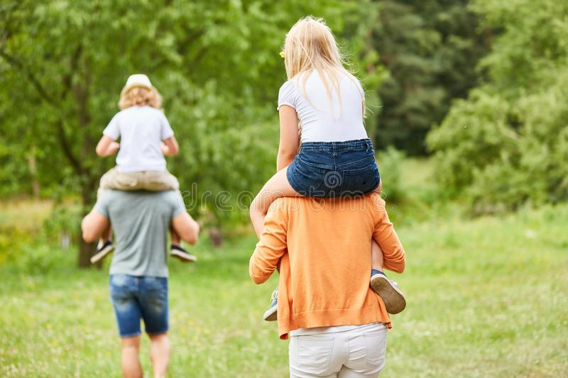 Family trip with children piggyback royalty free stock images