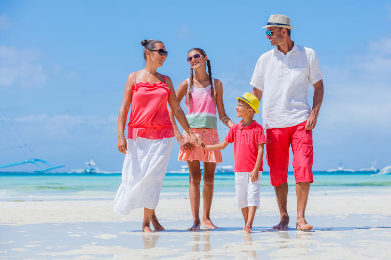 Family on tropical beach royalty free stock image