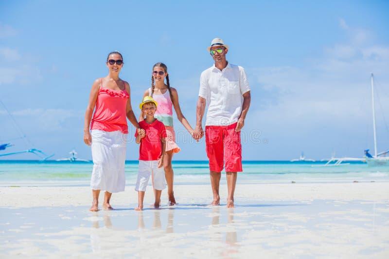 Family on tropical beach stock photography