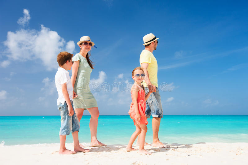 Family On A Tropical Beach Vacation Stock Photo