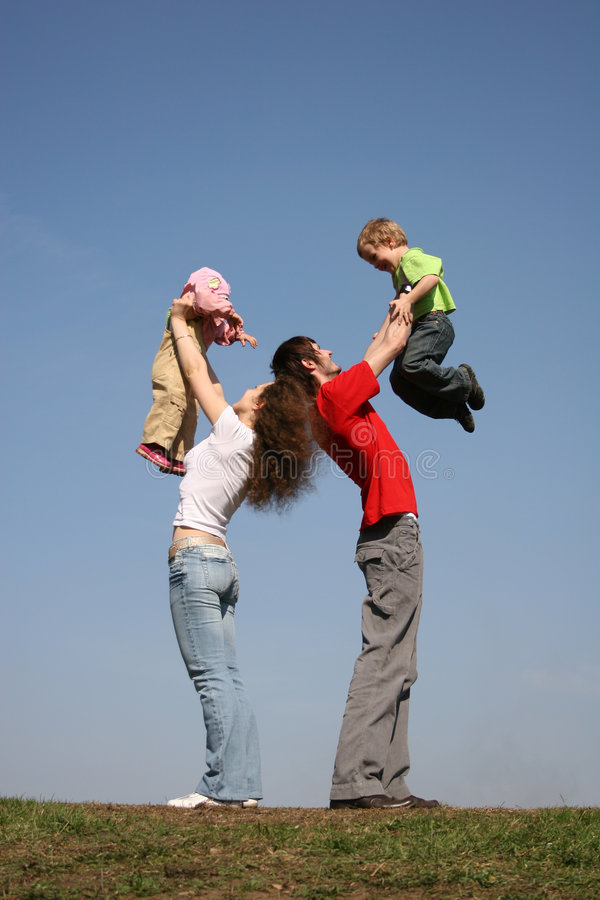 Family with two children on hands stock image