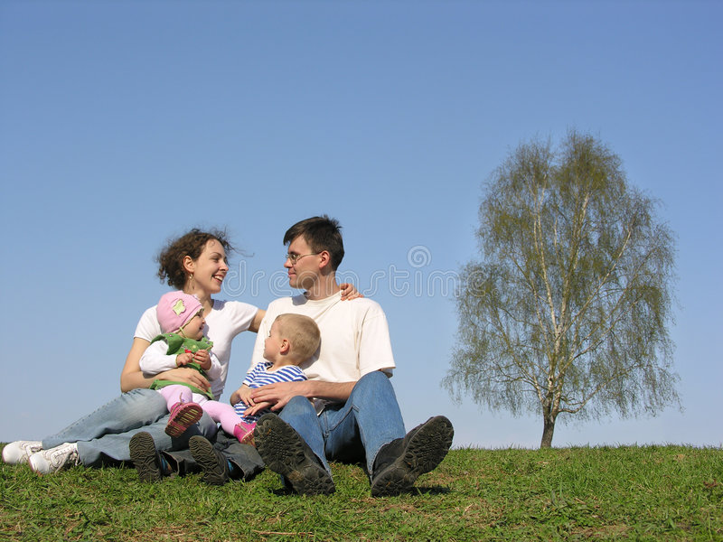 Family with two children. spring royalty free stock photos
