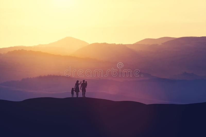 Family with two children standing on a hill vector illustration