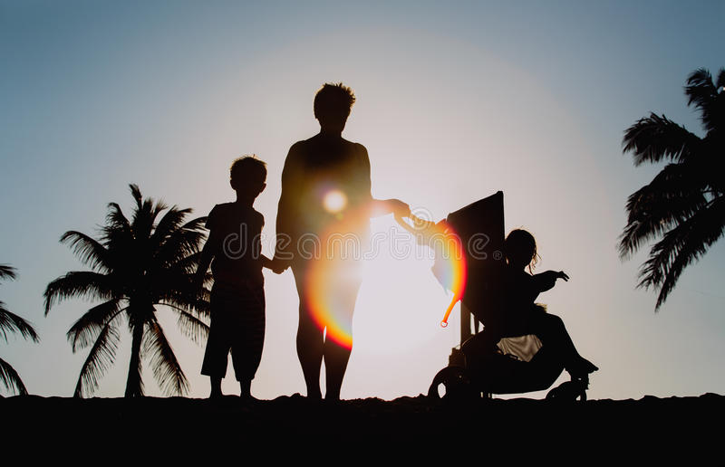 Download Family With Two Kids On Sunset Beach Stock Photo - Image of lifestyle, generation: 90289736