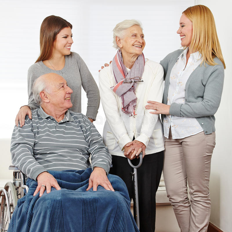 Family with two senior citizens at. Family with mother and daughter and two senior citizens at home royalty free stock photography