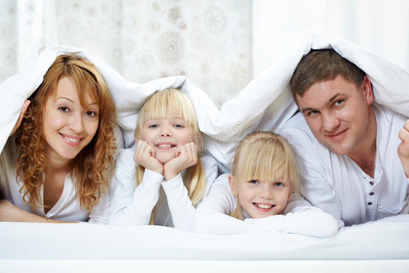 Family Under Blanket Stock Image