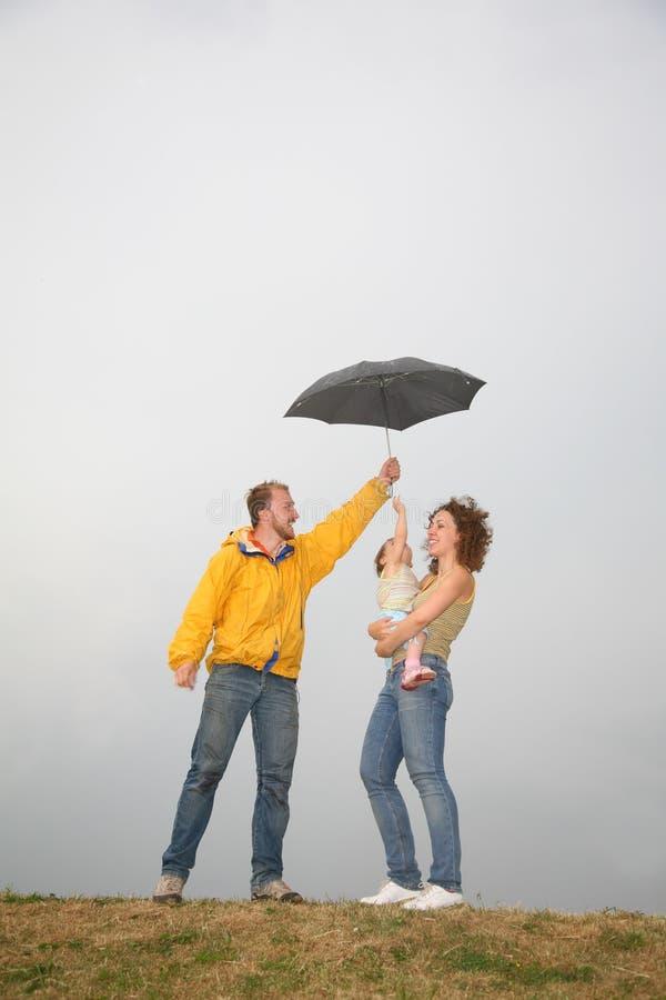 Download Family under umbrella stock photo. Image of activity, beauty - 2688638