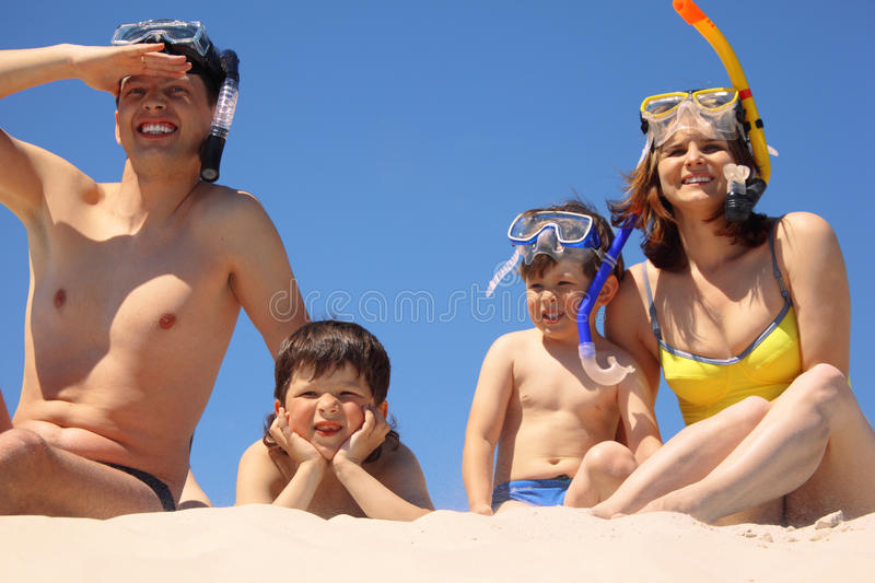 Download Family In Underwater Masks Sit On Sand Stock Photo - Image: 10699088