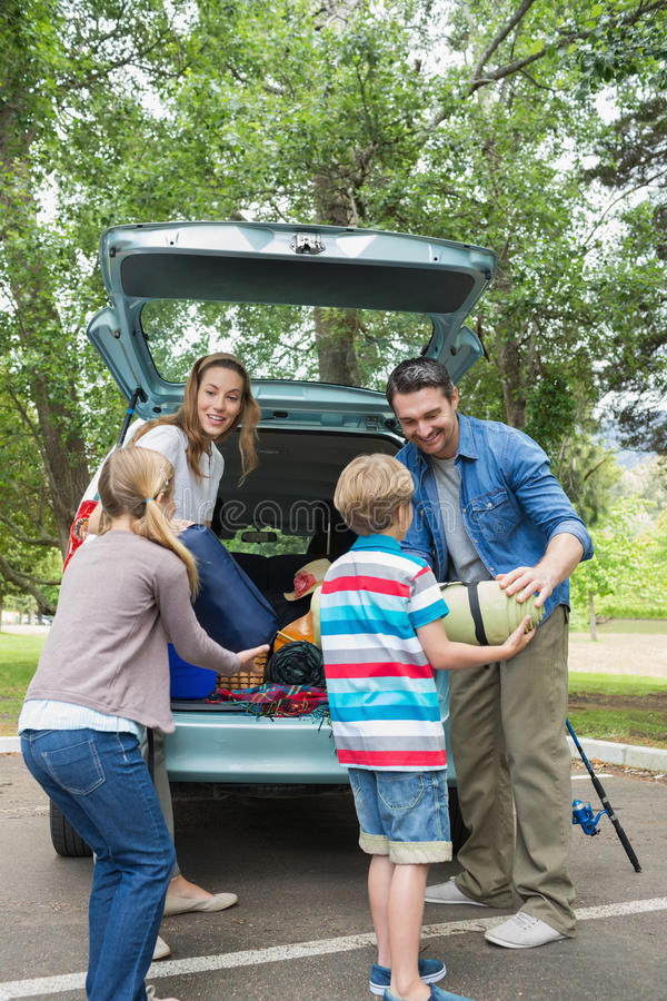 Family unloading car trunk while on picnic stock photos