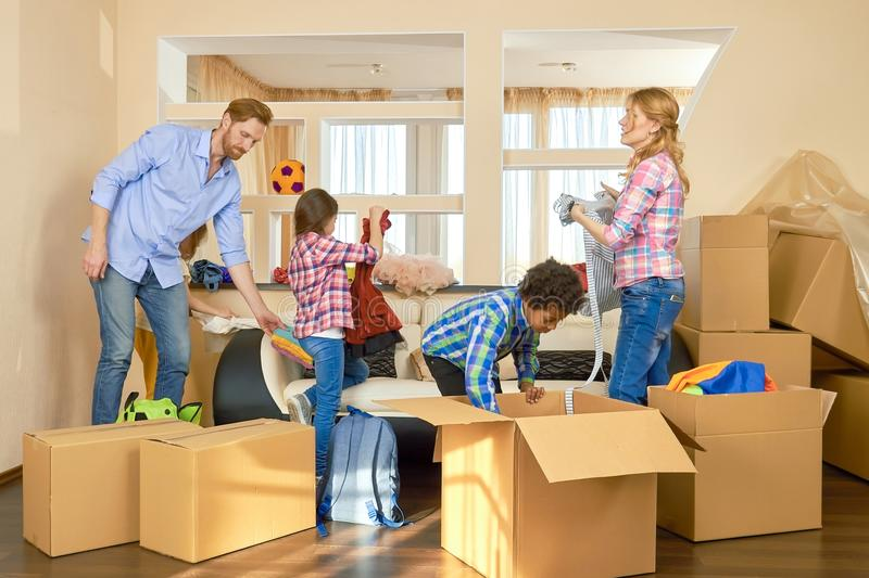 Family unpacking things from boxes. royalty free stock image