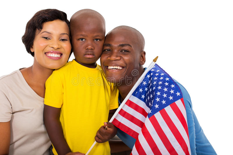 Family with usa flag. Afro american family with usa flag isolated on white background royalty free stock photography