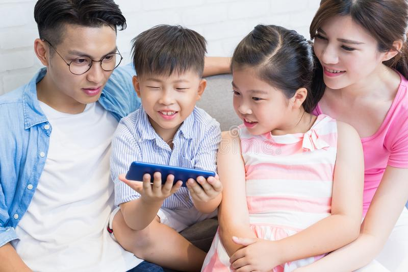 Family use phone watch movie. Happily at home stock images