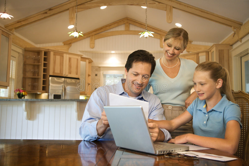 Family using computer royalty free stock image